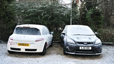 Renault Megane R26.R and Ford Focus RS500  covered in snow