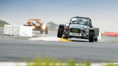 Ariel Atom and Caterham on track.