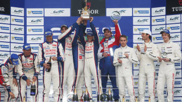 Anthony Davidson on the podium with the rest of the Toyota team