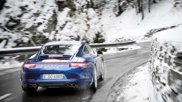 Porsche 911 Carrera 4S rear cornering shot in the snow
