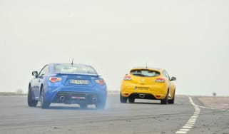 Subaru BRZ coupe and Renaultsport Megane 265 Trophy on track