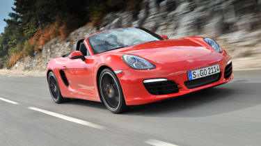 Porsche Boxster S driving, red with black wheels