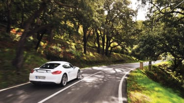 Porsche Cayman S 2013 rear, white, on the road in Portugal
