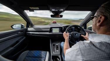 Hot hatchback triple – interior driving Golf