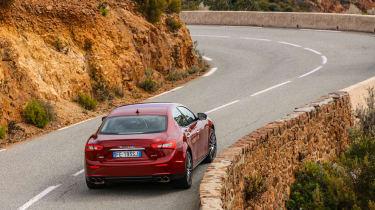 Maserati Ghibli 2016 - red driving rear