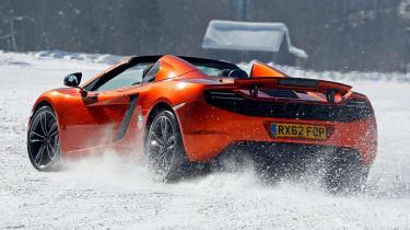 McLaren MP4-12C Spider orange on snow