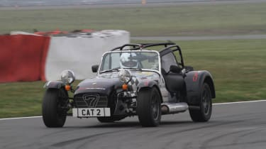 evo sprints a Caterham at Silverstone