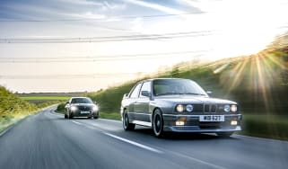 Two BMW M cars on the road