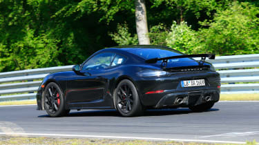 Porsche 718 Cayman GT4 on track - rear