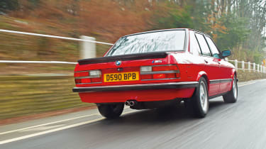 BMW M5 E28 red, rear driving picture