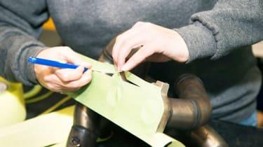 Masking exhaust manifold mounting flange