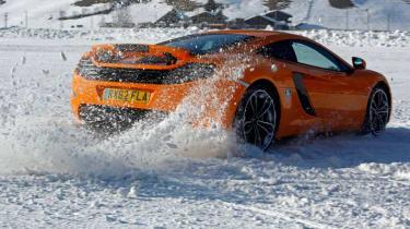 McLaren MP4-12C orange on snow