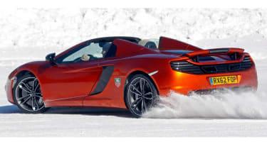 McLaren MP4-12C Spider roof down orange on snow