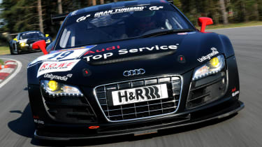 evo races an Audi R8 LMS at the Nurburgring 24 hours