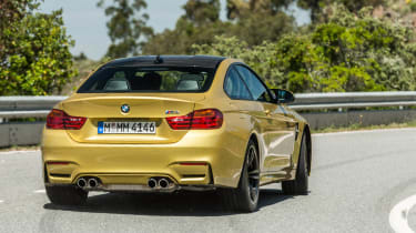 New BMW M4 yellow rear